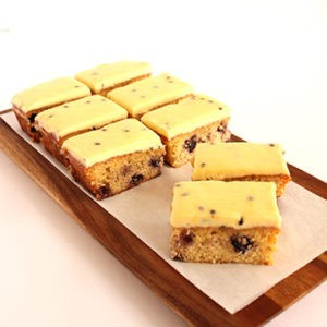 Slice Lemon & blueberry & polenta, passionfruit icing (gluten free – contains nuts)